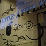 "gilded signage for ""the little apple"" store in Philadelphia, 2010"